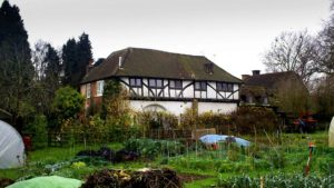 half-timbered house among allotments
