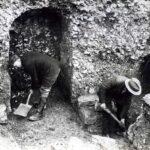 men digging with shovels